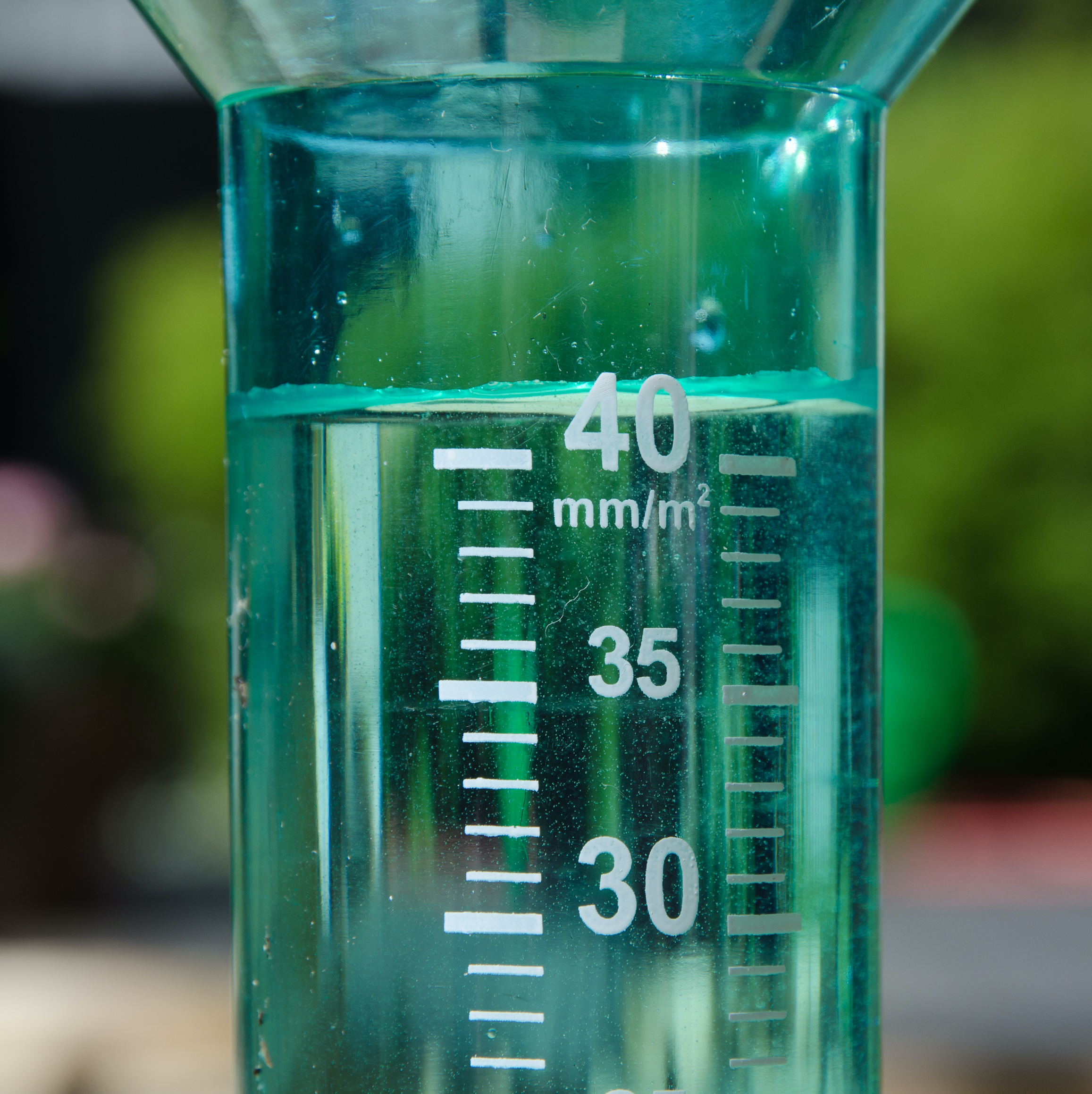 A filled rain gauge illustrating a rainy day