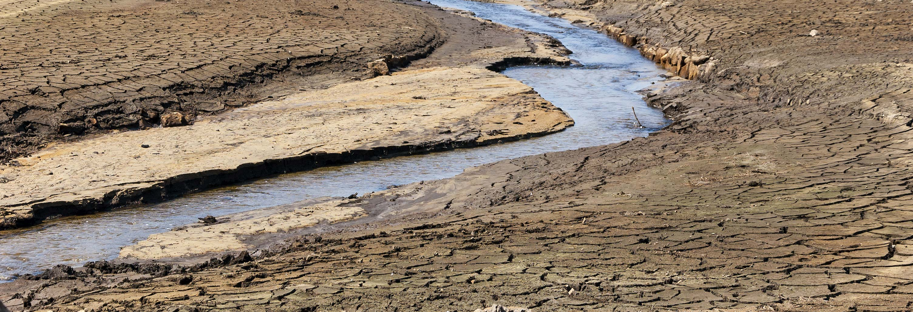 A river with dried and cracked soil